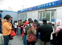 People get their transportation cards rechareged at bus station
