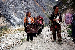 Tibetan pilgrims walk to pay their homage to Kang Karpo.